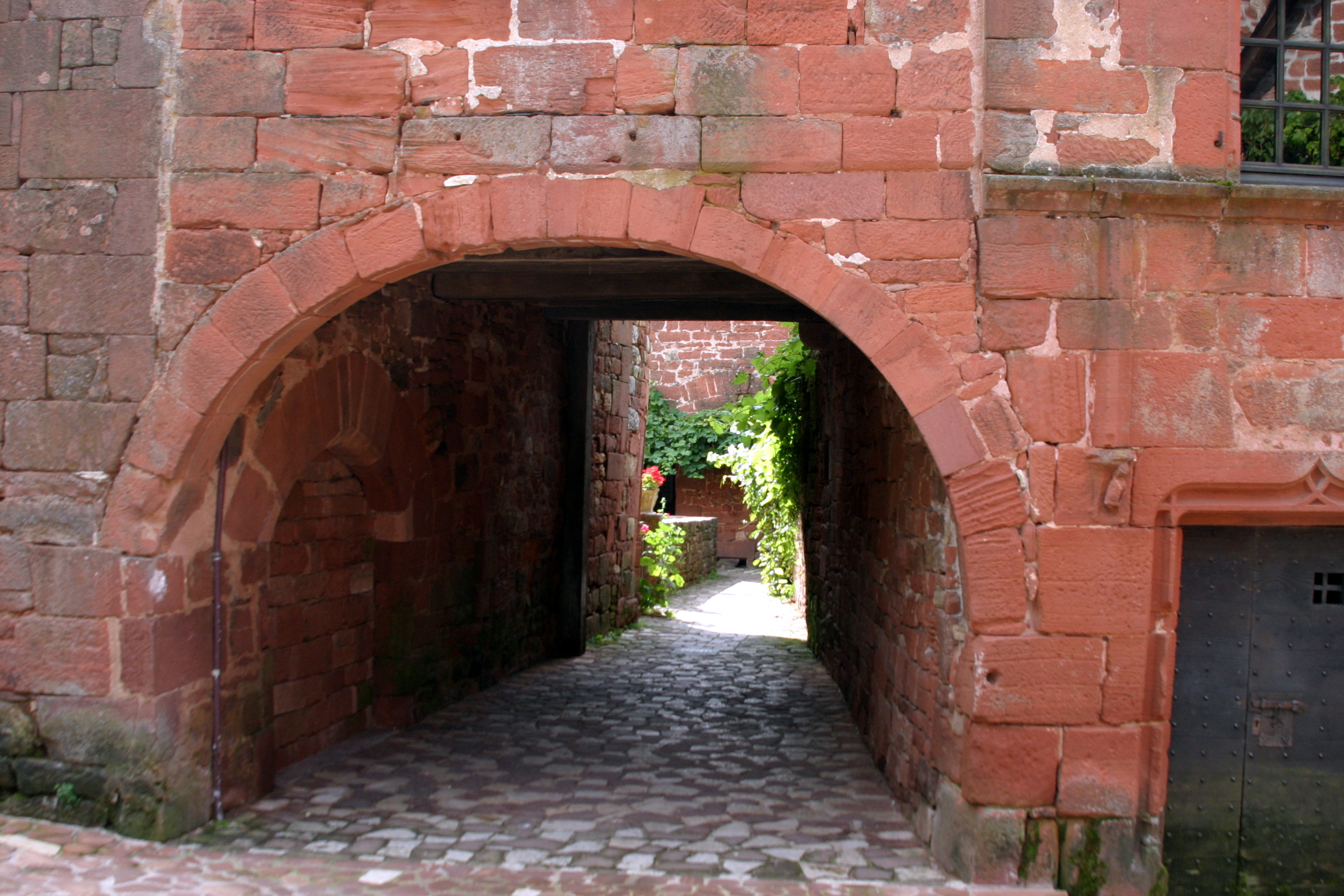 Collonges-la-Rouge, France - Through the arch