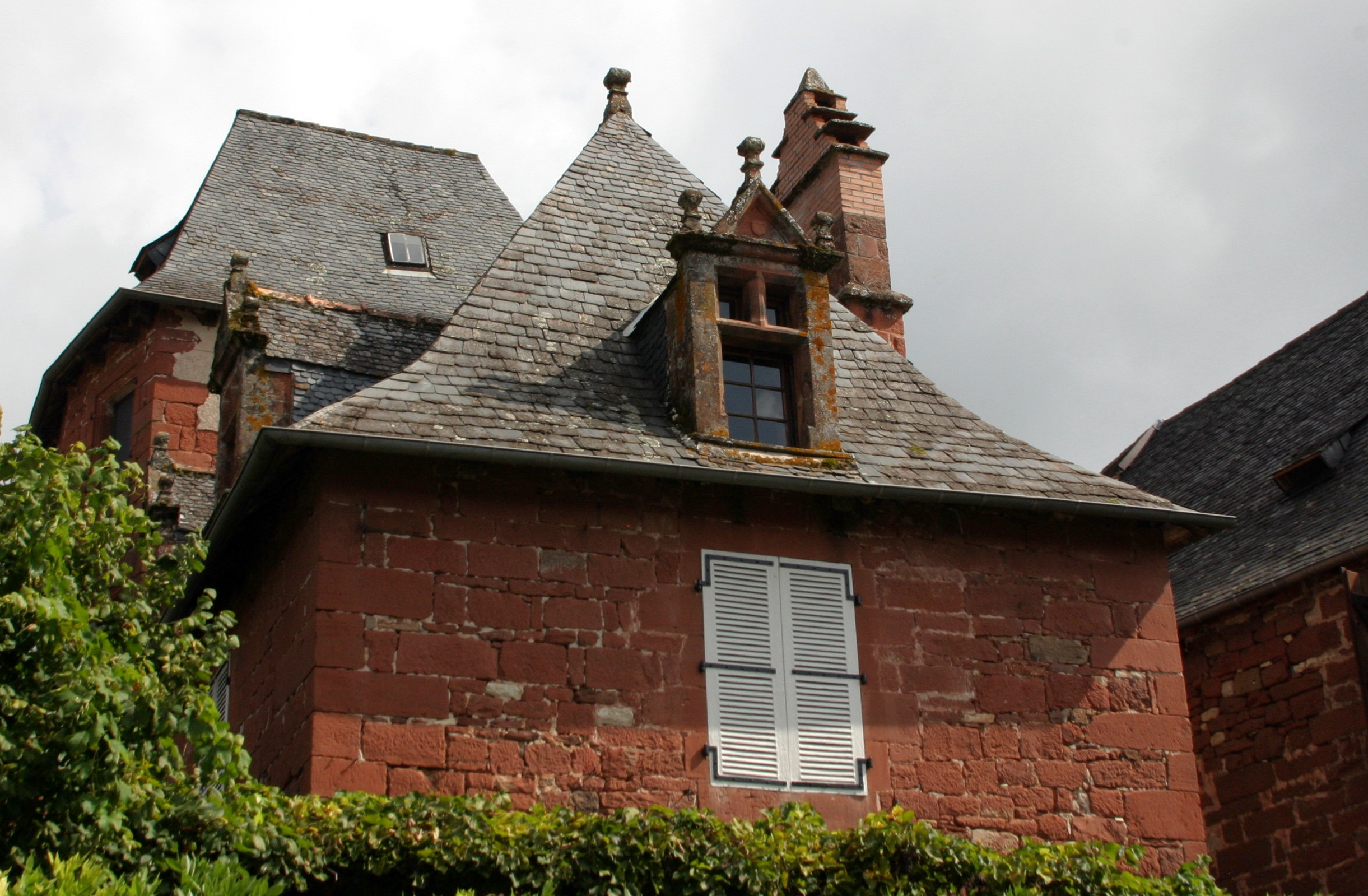 Collonges-la-Rouge, France - Happy window