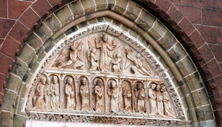 Collonges-la-Rouge, France - Saint-Pierre church entrance detail