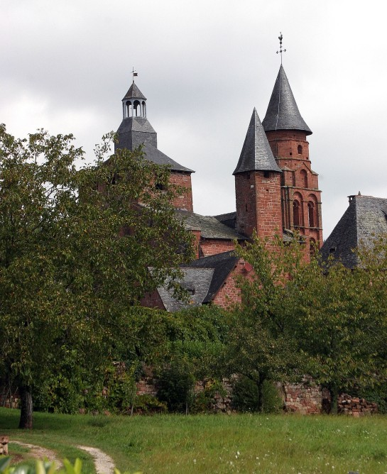 Collonges-la-Rouge, France - Saint-Pierre church's steeple and other roof features
