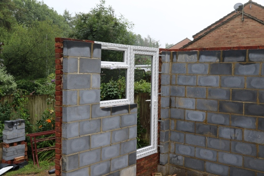 Conservatory - Utility Room door and window frames are in