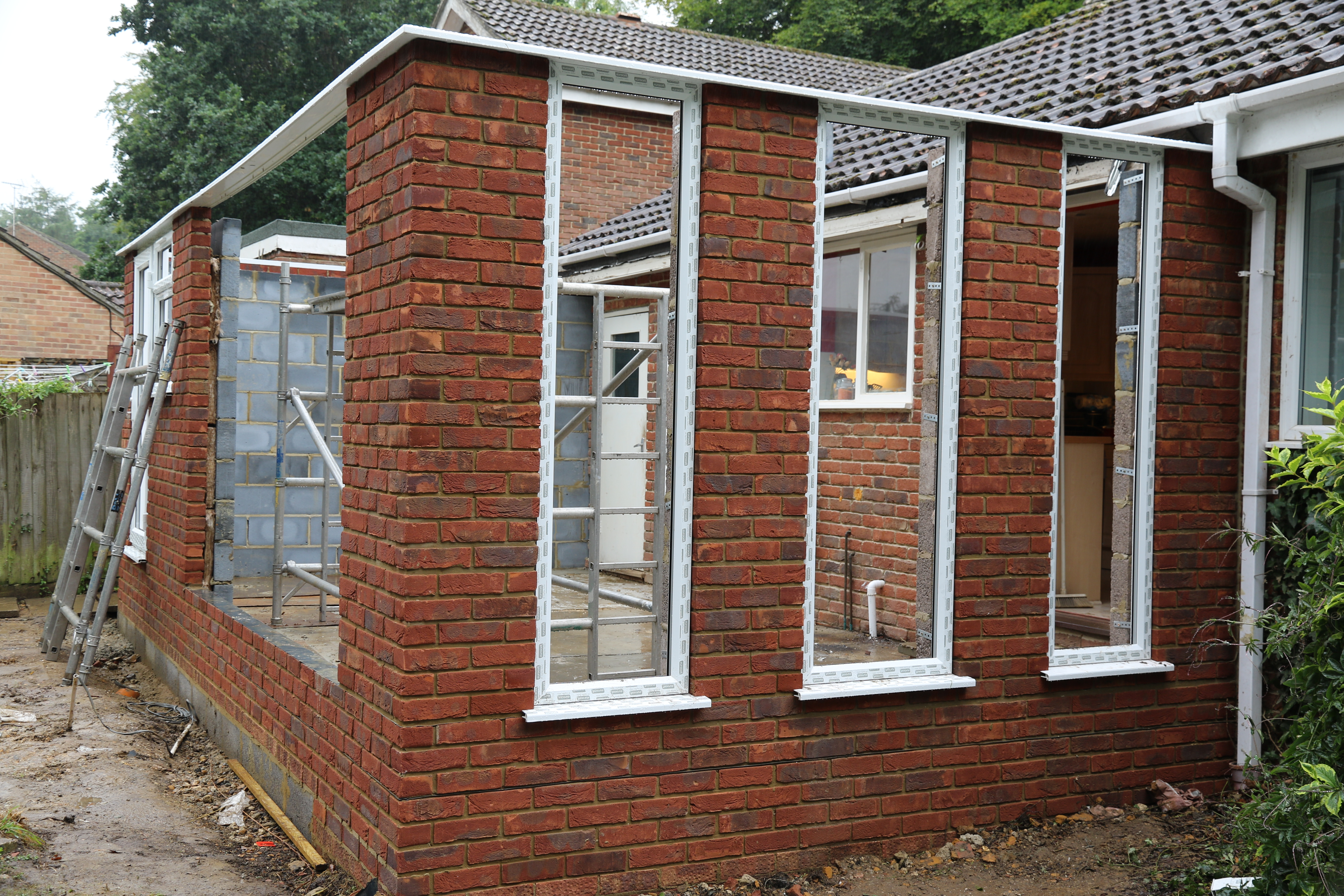 Conservatory - North end window frames are in. External view.