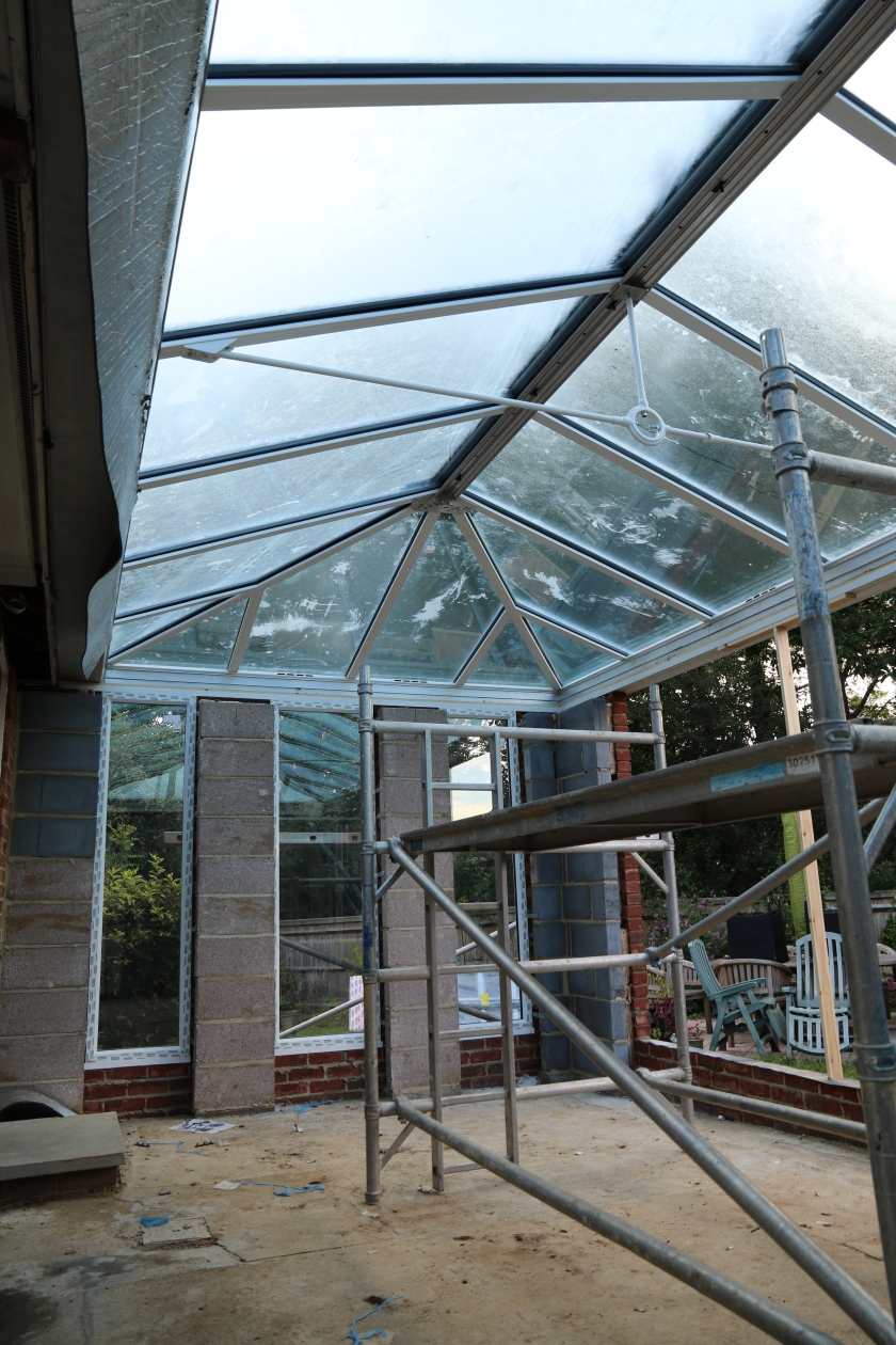 Conservatory - Early morning condensation helps to show new roof glazing panels in situ.
