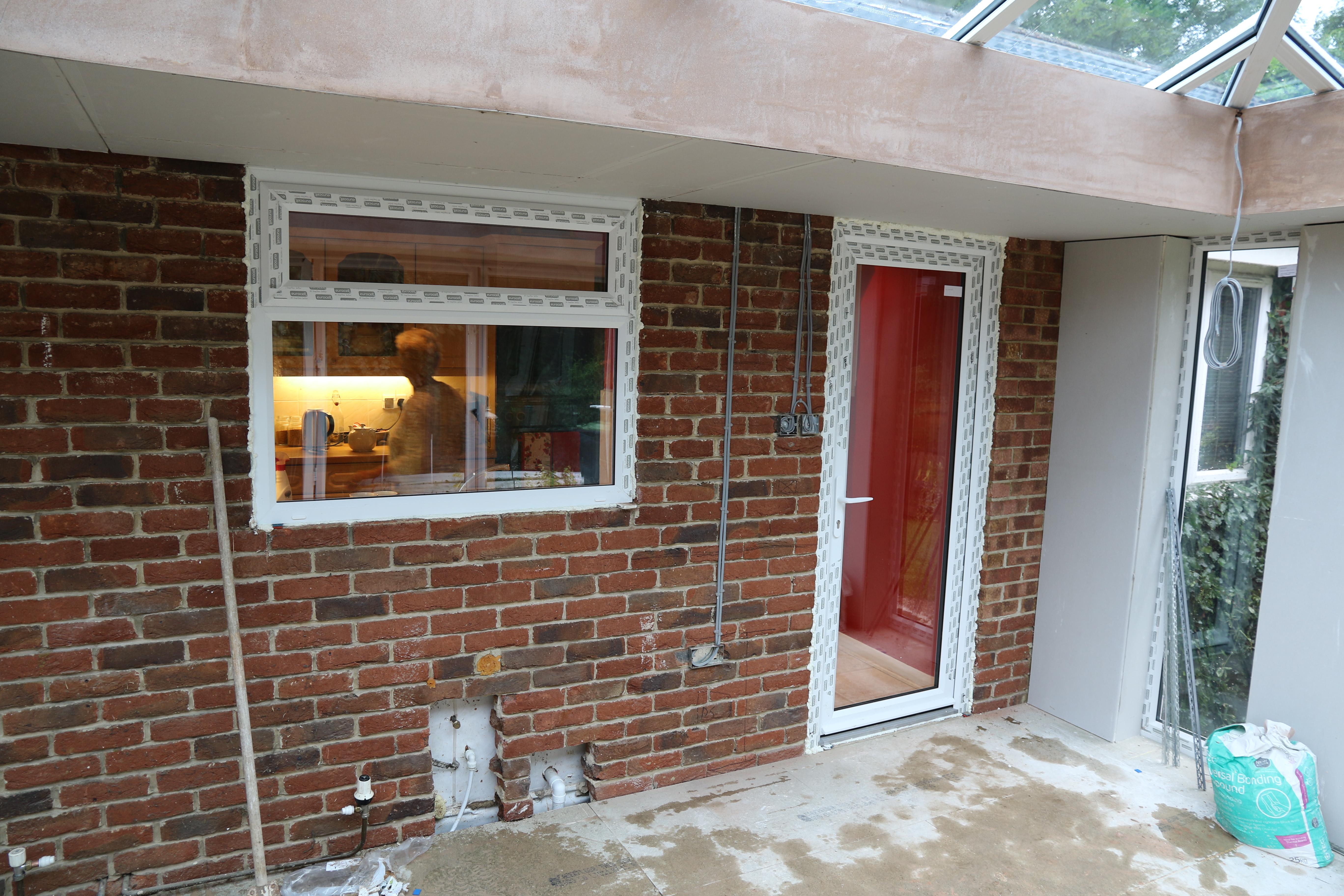 Conservatory - New kitchen door and window.