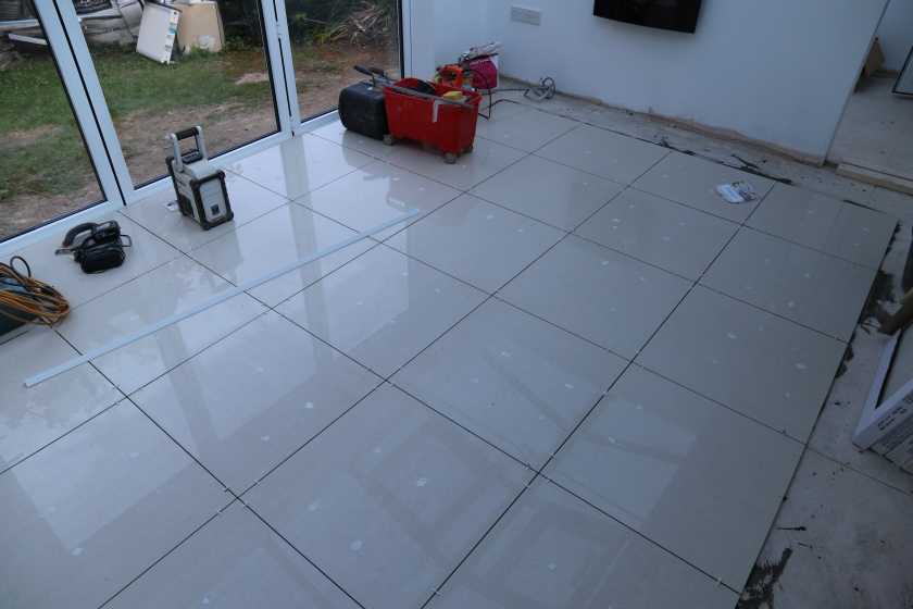 Conservatory - Floor tiling, no grout at this time.