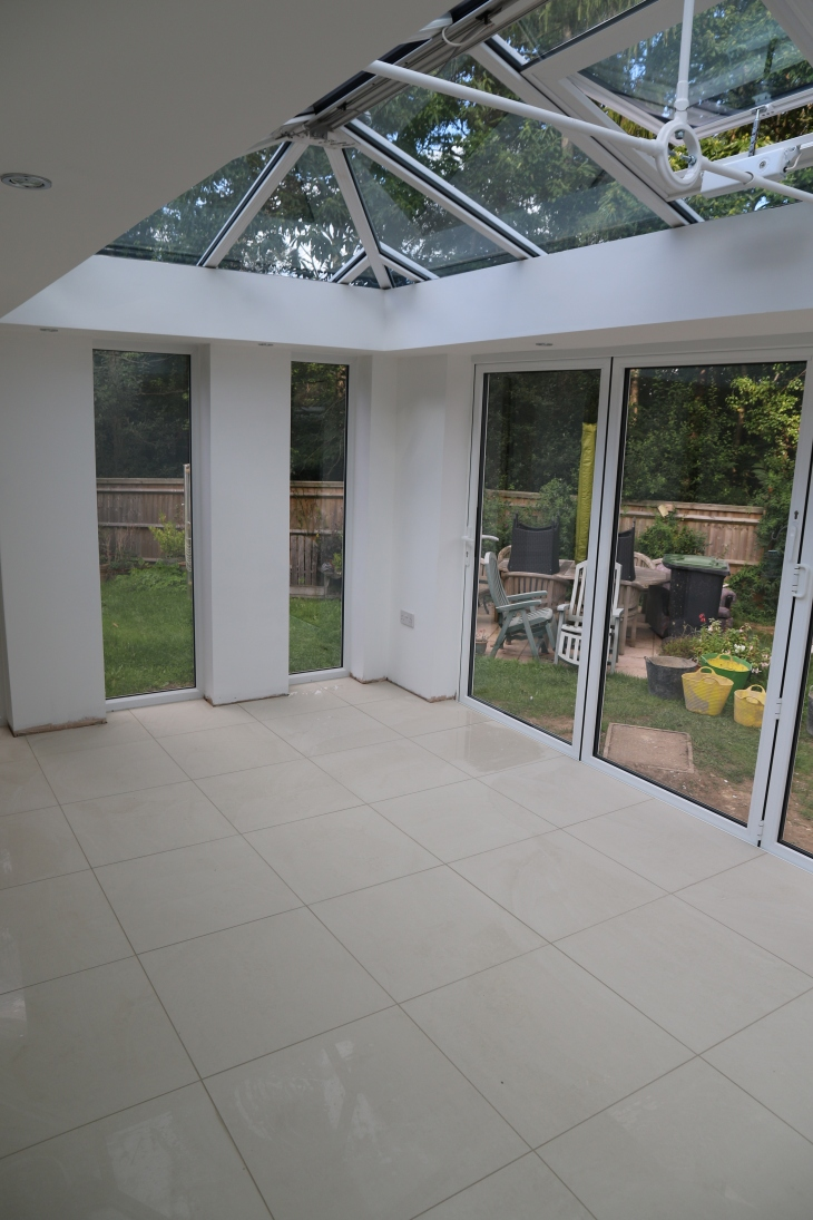 Conservatory - Tiles down and grouted.
