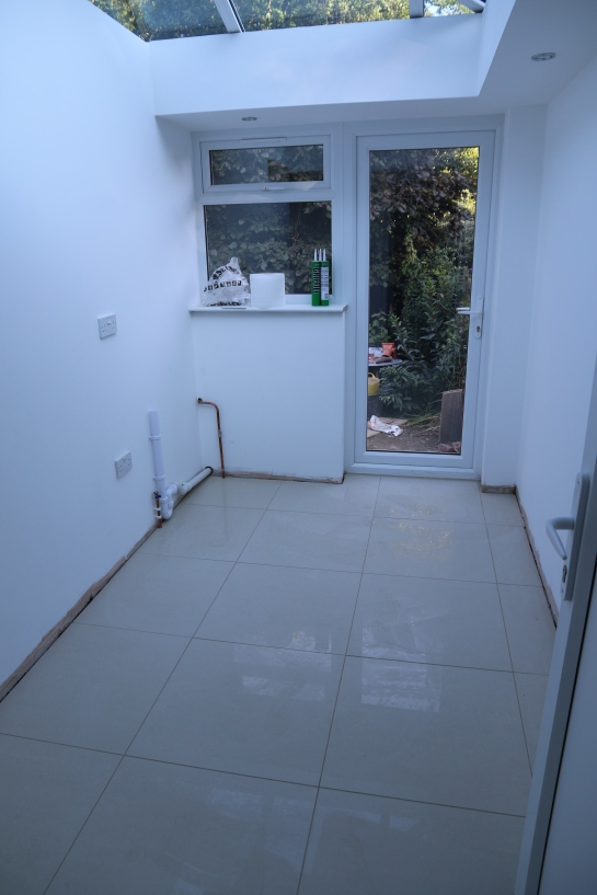 Conservatory - Utility room tiling has been laid and grouted
