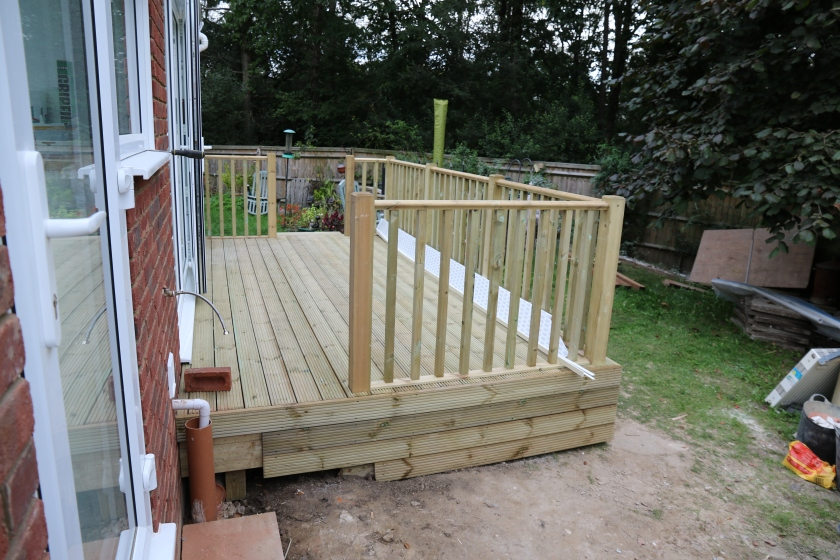 Conservatory - We have decking, access from the utility room end. we just have to have the steps built to join with this.