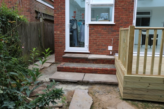 Conservatory - Steps to utility room door and alternative access to the decking.