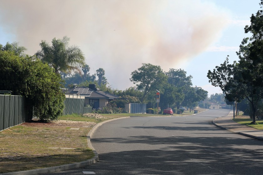 Smoke drifting down the road - Bushfire