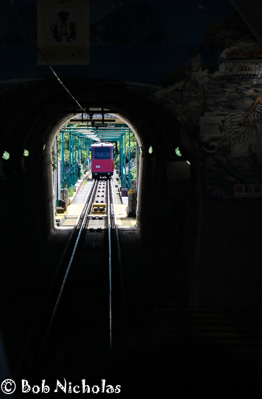 """Capri - Funicolare, view inside the """"station"""" looking up the railway as the carriage arrives."""