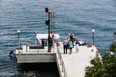 The Jetty, Towers Hotel - Intrepid travellers waiting to board the shuttle boat to Sorrento