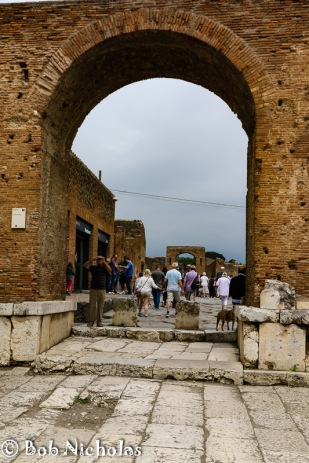 Pompeii - Forum Arch in Honor of Nero Caesar; Arch of Caligola is in the Background.