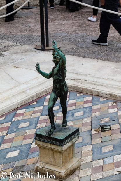 Pompeii - The House Of The Faun. The house is named after this statue, although this is just a replica of the original.