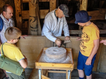 Lurgashall Watermill - Hands on demonstration. One hours hand grinding would produce enough flour for a single loaf.